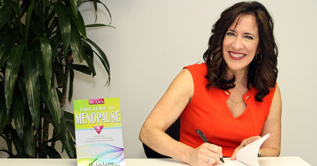 Dr. Liz Signing a Copy for Easy Guide to Menopause