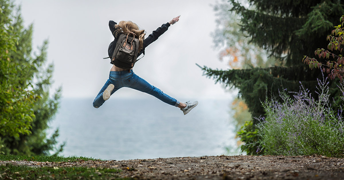 Empowered Woman Jumping in the Air