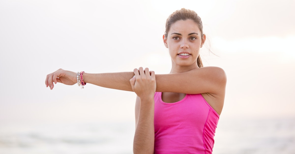 Healthy woman stretching arm fitness weightloss