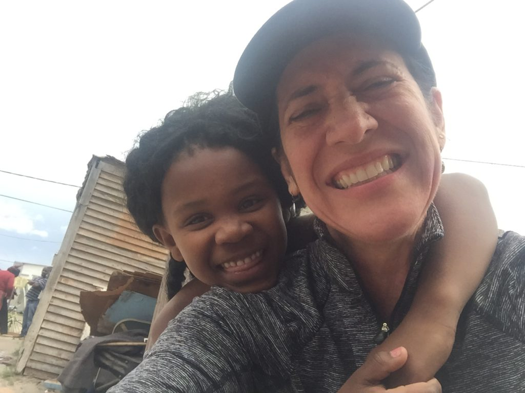 Dr. Liz Lyster Smiling With a Young Girl