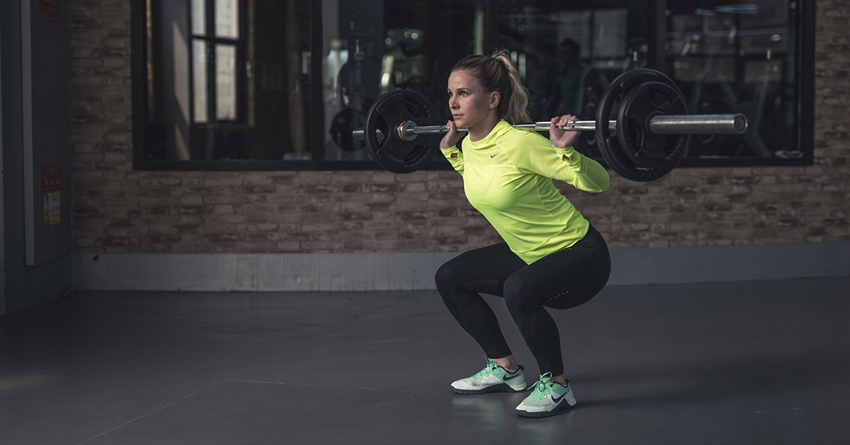 Woman Lifting Weights to Combat Belly Fat