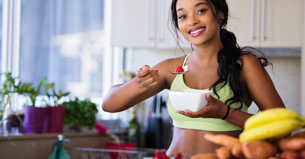 healthy woman eating healthy food supplement support immune system
